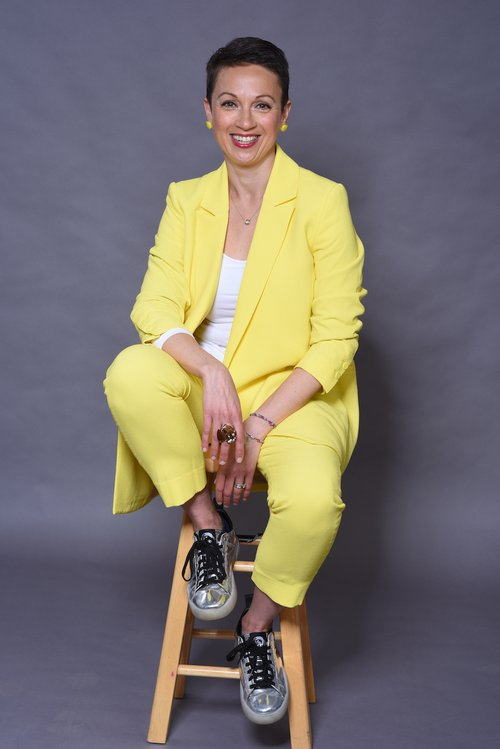 Nataly on chair in yellow - side view