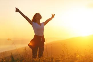 woman in field sunshine